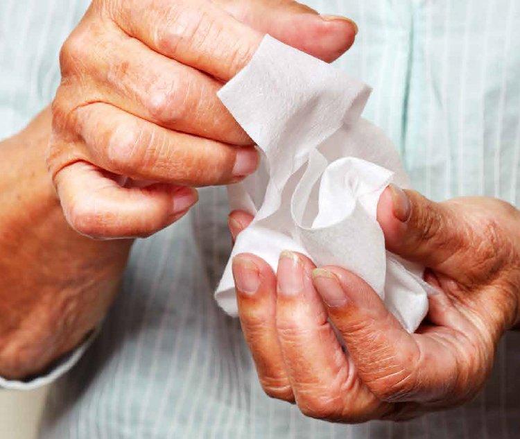 Hands refreshing wipe